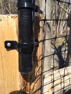 Clamps secure extension posts to existing fence.