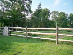Garden Fence in front of split rail fencing